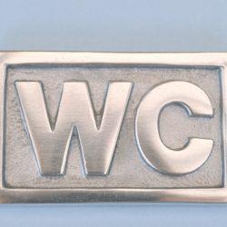 Skylt WC aluminium