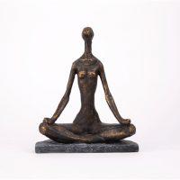 statyett yoga sittande